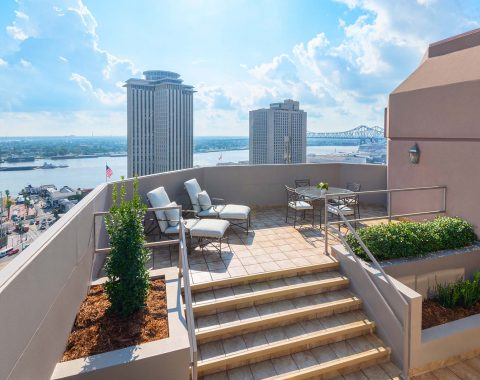 Picturesque scene from the terrace at Windsor Court Hotel, featuring a panoramic view of the Mississippi River