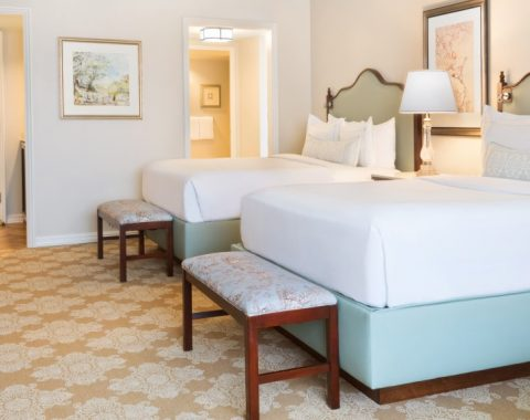One of the guestrooms at Windsor Court Hotel featuring two queen beds