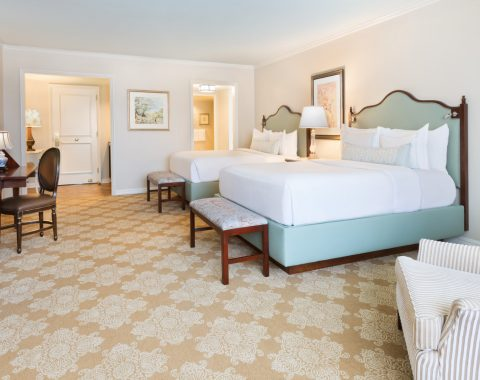 guest room featuring two queen beds