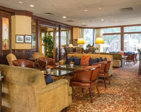 polo club lounge at Windsor Court Hotel features plush leather furniture and dark wood finishes