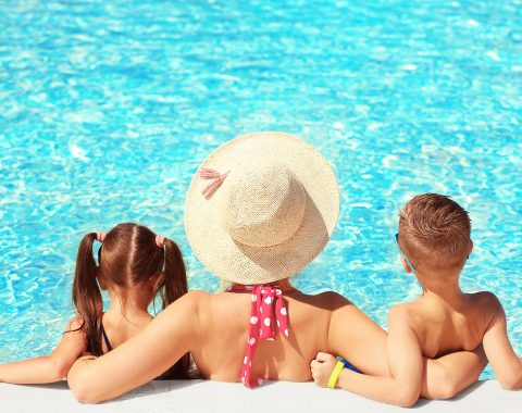 A mother and two children in the pool at windsor court hotel