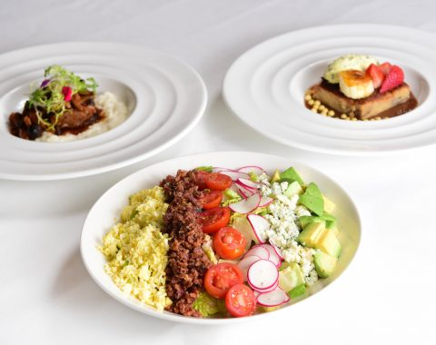 Multiple dishes from The Grill Room New Orleans including the Windsor Court Salad